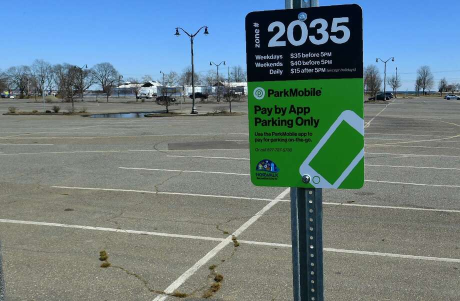 The parking lot at Calf Pasture Beach Tuesday, March 26, 2019, in Norwalk, Conn. People trying to enjoy the 60 degree weather at Calf Pasture Beach on Sunday afternoon were turned away after police closed the park more than four hours because of an unauthorized car show. Photo: Erik Trautmann / Hearst Connecticut Media / Norwalk Hour