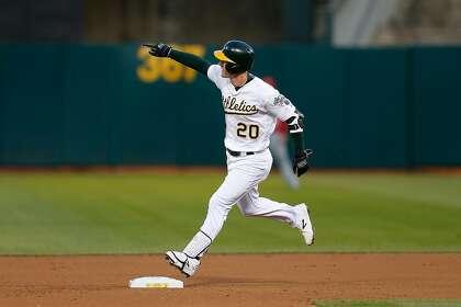 A's Mark Canha proclaims it's 'bat-flipping season'
