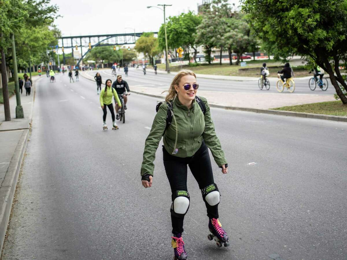 Skaters and bikers make their way down S. St. Mary's Street during the biannual Siclovia in downtown San Antonio on Sunday, March 31, 2019.