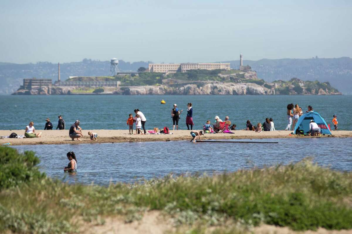 People enjoy sunny day on the beach at Crissy Field in San Francisco in a welcome break from a series of rainstorms.
