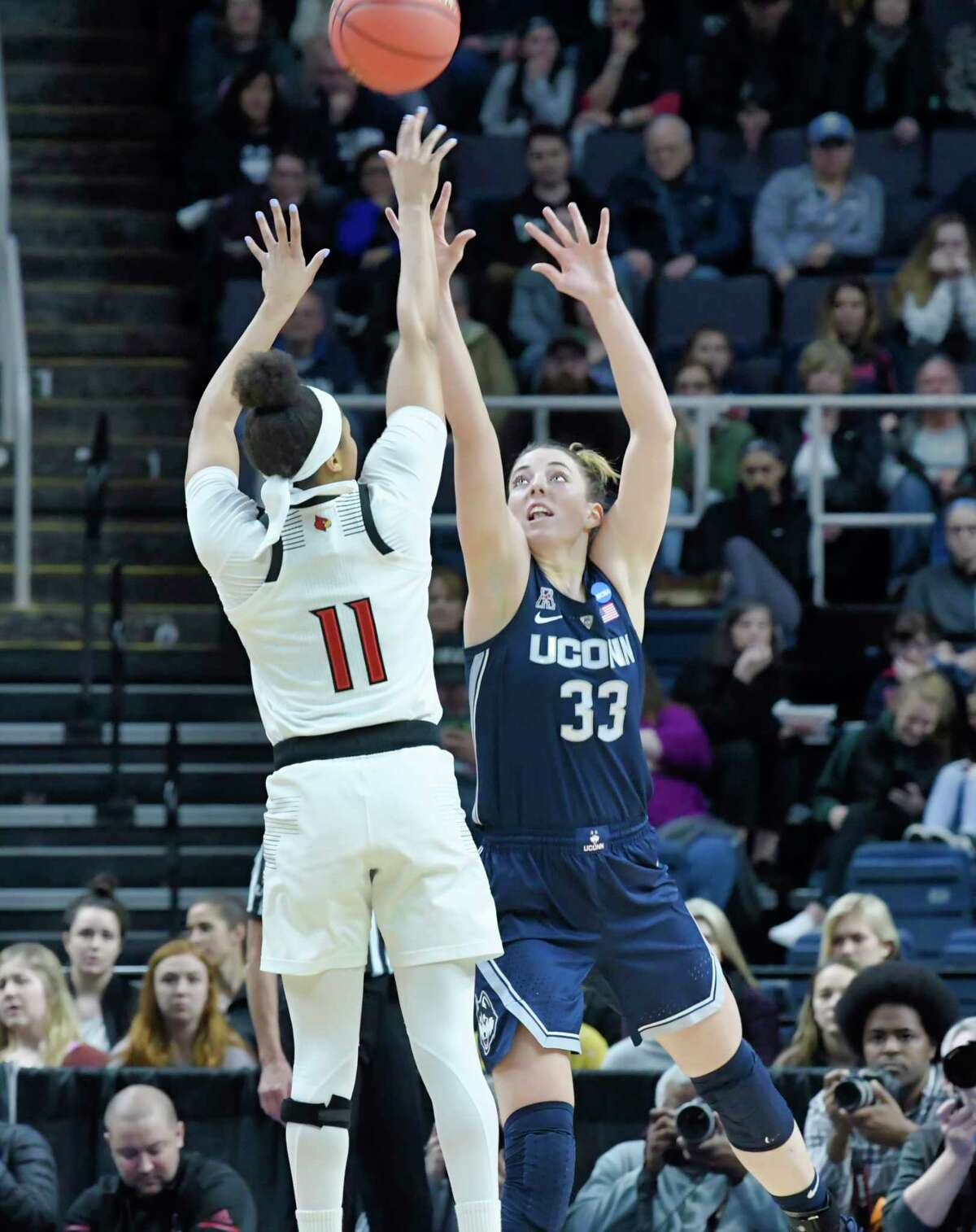 Arica Carter, left, of Louisville, puts up a shot over Katie Lou Samuelson of UConn during the final of the Albany Regional NCAA Women's Basketball Championship on Sunday, March 31, 2019, in Albany, N.Y. (Paul Buckowski/Times Union)