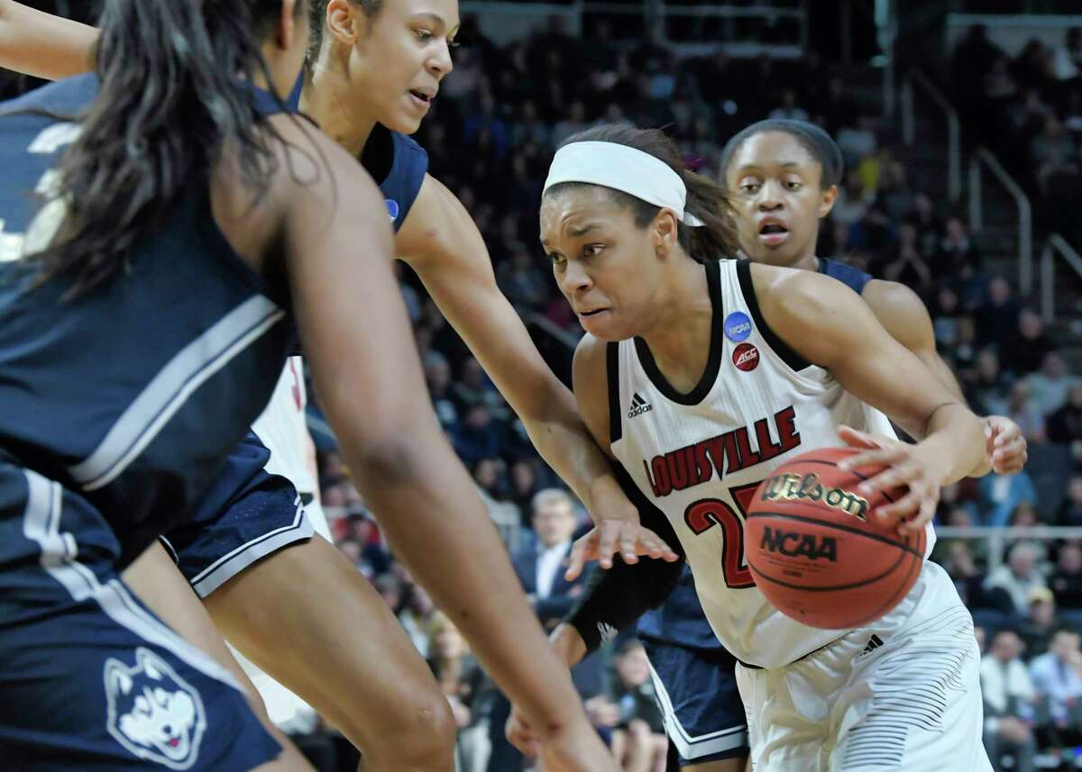 Asia Durr of Louisville tries to find a way to the basket through UConn players during the final of the Albany Regional NCAA Women's Basketball Championship on Sunday, March 31, 2019, in Albany, N.Y. (Paul Buckowski/Times Union)