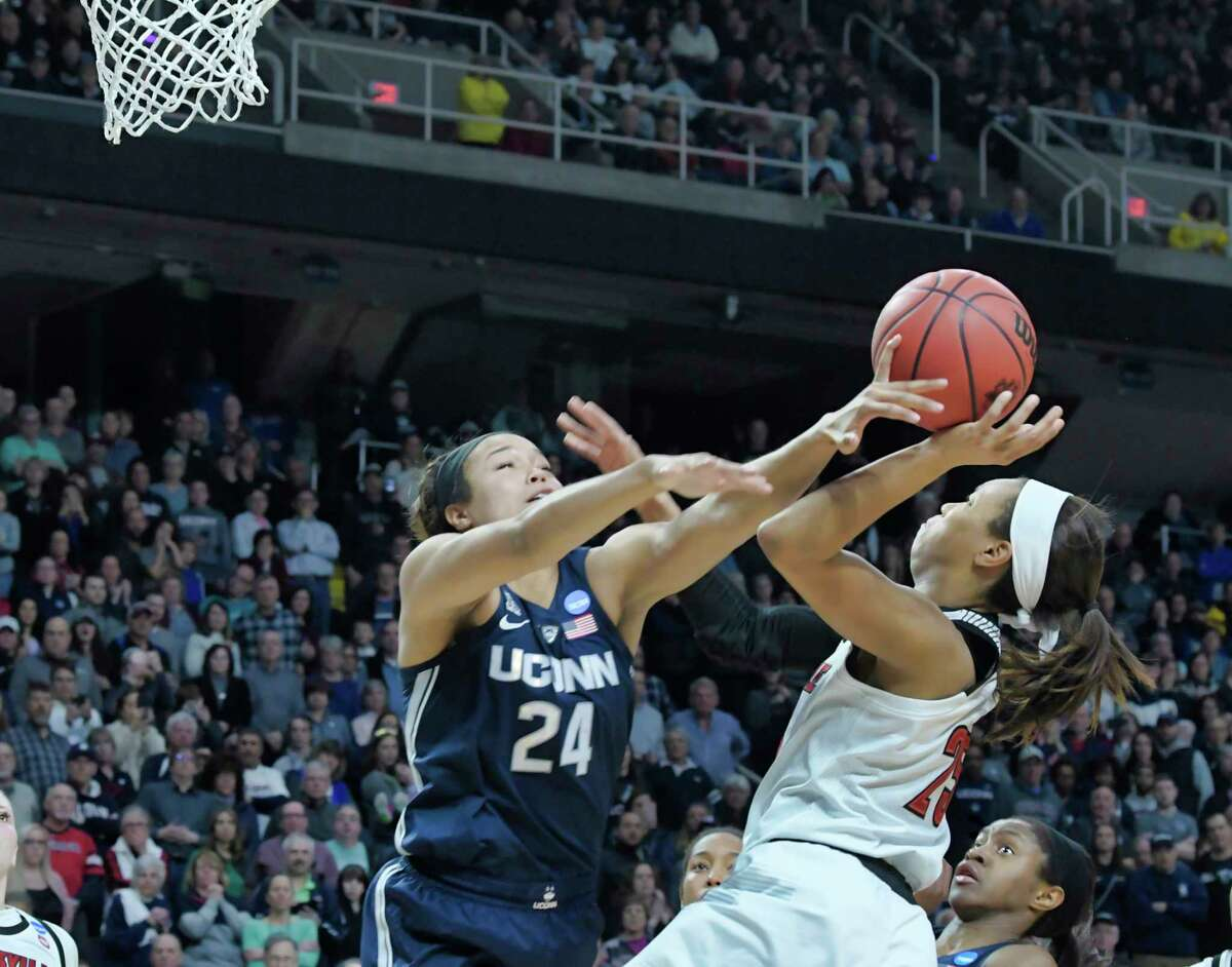 Napheesa Collier, left, of UConn, tries to stop the shot of Asia Durr of Louisville during the final of the Albany Regional NCAA Women's Basketball Championship on Sunday, March 31, 2019, in Albany, N.Y. (Paul Buckowski/Times Union)