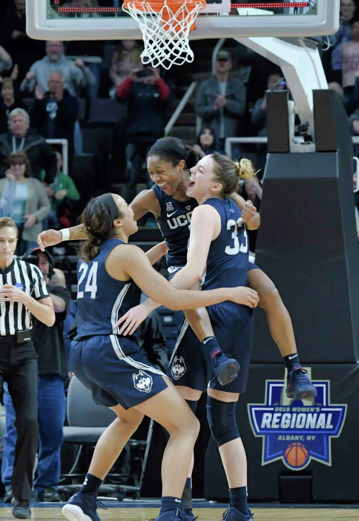 UConn's Napheesa Collier, left, Crystal Dangerfield, center, and Katie Lou Samuelson celebrate their win over Louisville in the final of the Albany Regional NCAA Women's Basketball Championship on Sunday, March 31, 2019, in Albany, N.Y. (Paul Buckowski/Times Union)
