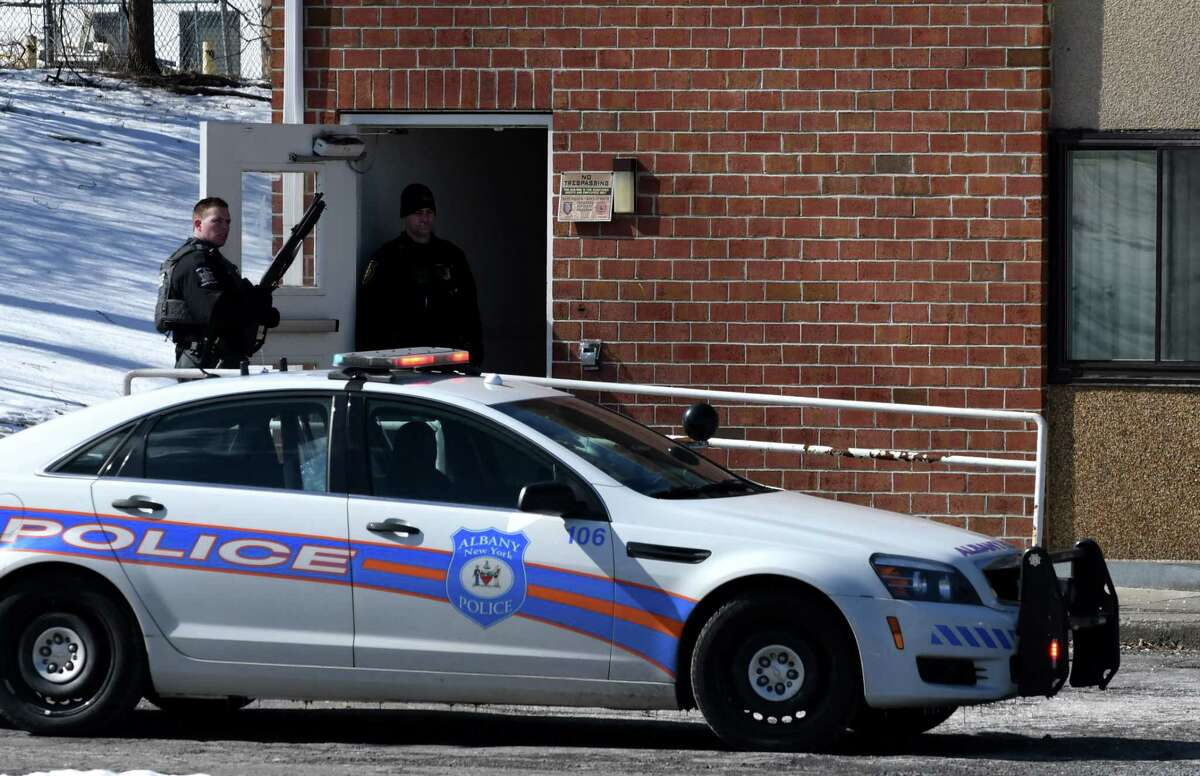 State and Albany police members take part in the search bank robbery suspects at a Motel 6 hotel on Watervliet Ave. Ext. on Tuesday, Feb. 26, 2019, in Albany, N.Y. (Will Waldron/Times Union)