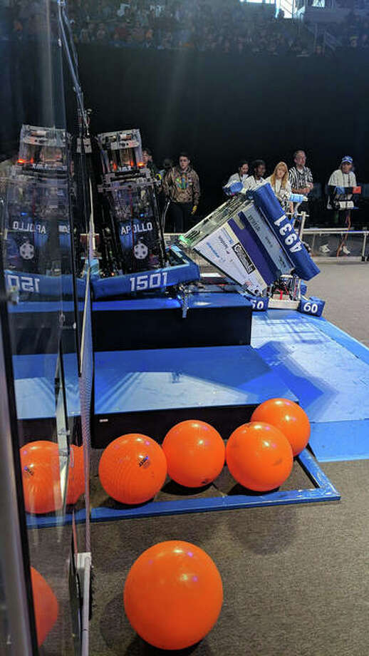 Edwardsville Technologies' robot, Buzz, flips itself onto an alliance robot during a qualification round during the St. Louis Regional Robotics Comeptition March 15-16 at Chaifetz Arena in St. Louis. Photo: For The Intelligencer