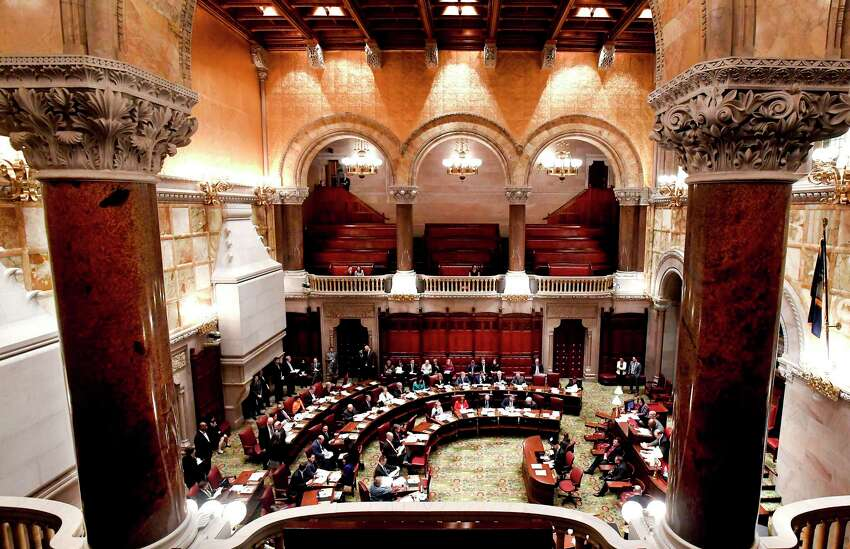 Members of the New York state Senate debate budget bills during session in Senate Chamber at the state Capitol Sunday, March, 31, 2019, in Albany, N.Y.
