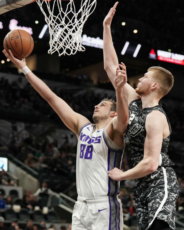Sacramento Kings' Nemanja Bjelica (88) attempts to shoot against San Antonio Spurs' Davis Bertans during the first half of an NBA basketball game, Sunday, March 31, 2019, in San Antonio. (AP Photo/Darren Abate)