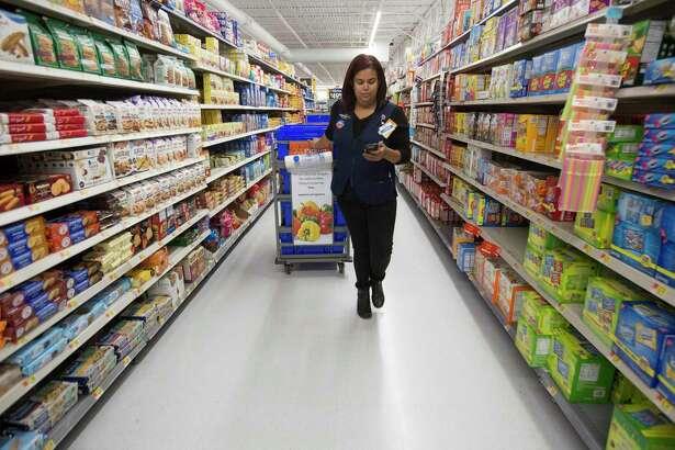 New Braunfels Walmart Supercenter employee Coren Gomez shops for customers' online orders.