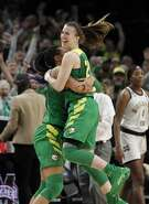Oregon forward Satou Sabally, left, and Oregon guard Sabrina Ionescu, right, celebrate a regional final victory over Mississippi State in the NCAA women's college basketball tournament Sunday, March 31, 2019, in Portland, Ore. Oregon defeated Mississippi State 88-84. (AP Photo/Steve Dipaola)