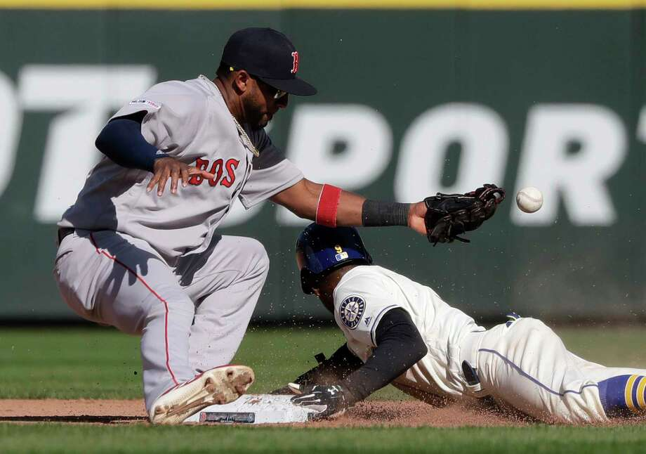 Seattle Mariners' Dee Gordon, right safely steals second base as the ball pops out of the glove of Boston Red Sox second baseman Eduardo Nunez during the seventh inning of a baseball game, Sunday, March 31, 2019, in Seattle. (AP Photo/Ted S. Warren) Photo: Ted S. Warren / Copyright 2019 The Associated Press. All rights reserved.