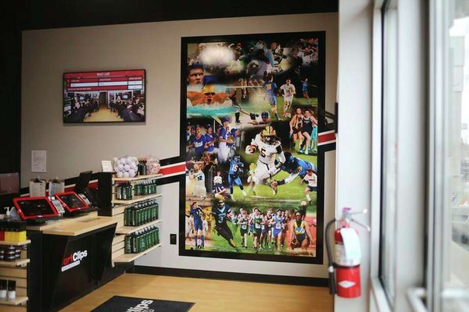 FILE — SportClips is located at 219 W. Wackerly St. in Midland. The shop features a photo mural of local athletes. (Katy Kildee/kkildee@mdn.net)
