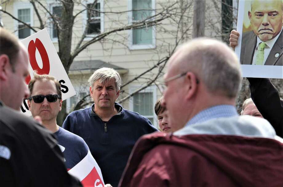 Protesters in Stratford called for passing cars to honk against tolls Saturday on the Paradise Green in the center of town. The protest one of five around the state Saturday organized by No Tolls CT, attracted about 100 people including Bob Stefanowski, the Republican candidate for governor who ran opposed to tolls, shown here. At right is a picture of House Speaker Joe Aresimiwicz, a toll proponent. Photo: Dan Haar/Hearst Connecticut Media