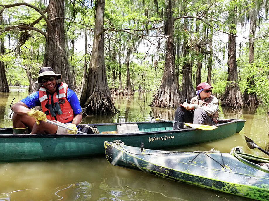 Intern Andrew Miller (left) and volunteer Jake Ballard (right) conducting colonial water bird surveys on Champion Lake. Photo: File Photo