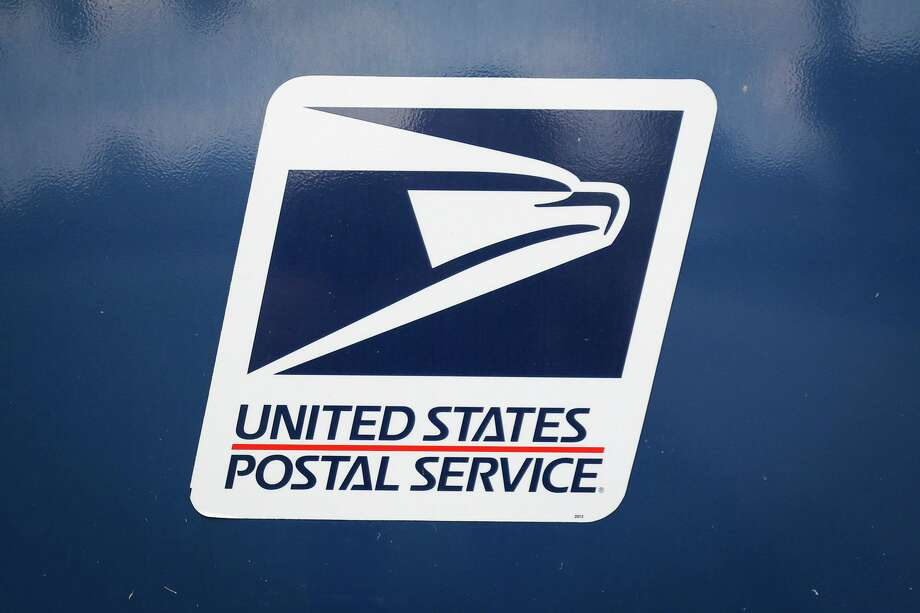 A U.S. Postal Service mailbox is pictured outside of the post office off of West Dallas Street on Friday, Sept. 1, 2017, in Conroe. Photo: File Photo / © 2017 Houston Chronicle