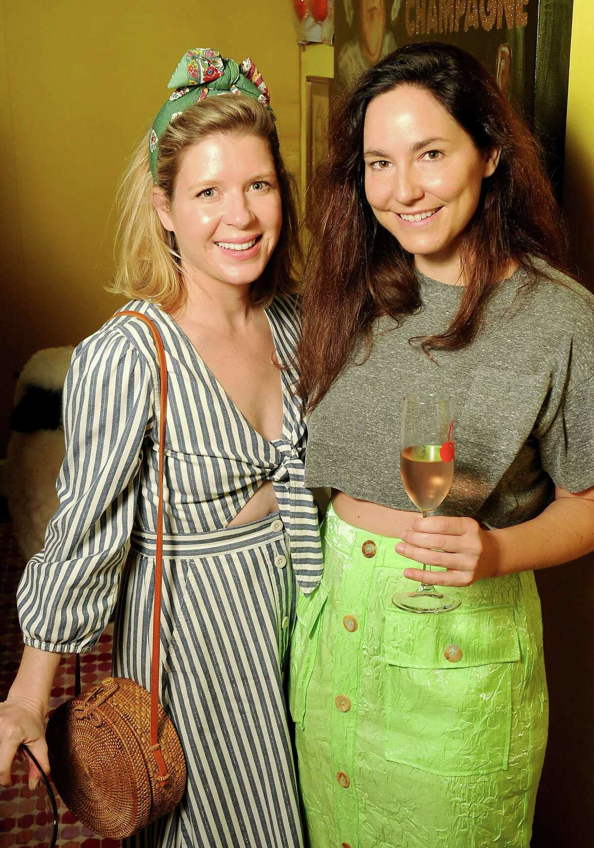 Illa Gaunt and Kelly Barnhart at a launch party for the Cherry App at the home of Bailey McCarthy Friday March 29,2019. (Dave Rossman Photo)