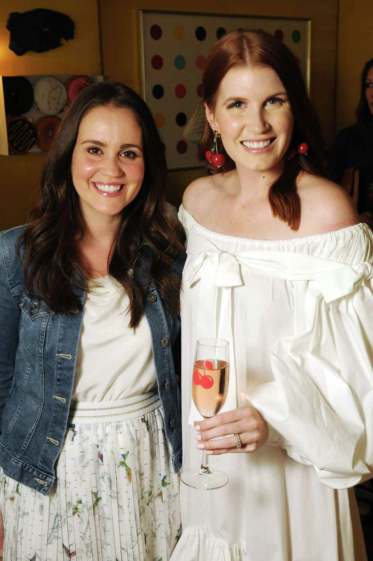 Marie Flanagan and Amber Venz Box at a launch party for the Cherry App at the home of Bailey McCarthy Friday March 29,2019. (Dave Rossman Photo)