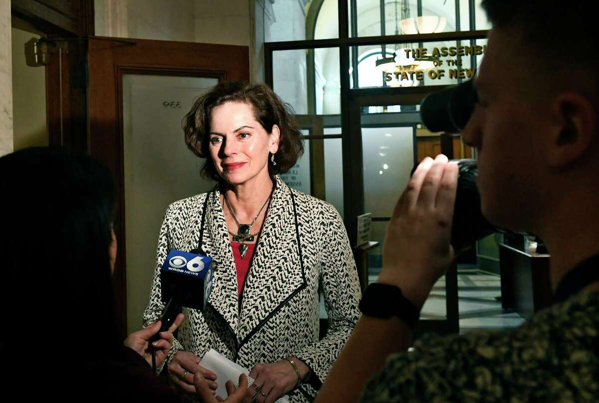 Assemblywoman Patricia Fahy, D-Albany, talks with reporters outside the Assembly Chamber after legislators completed the state budget in the early morning hours at the state Capitol Monday, April 1, 2019, in Albany, N.Y.