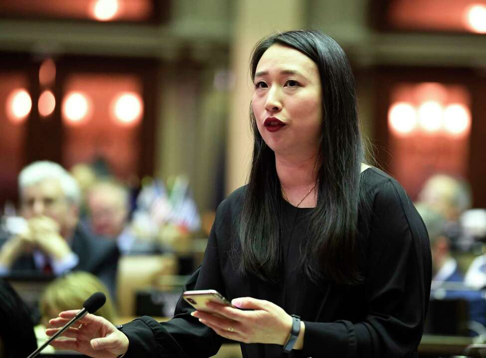 Assemblywoman Yuh-Line Niou, D-New York, speaks as members of the Assembly debate budget bills in the Assembly Chamber at the state Capitol, Sunday, March, 31, 2019, in Albany, N.Y.