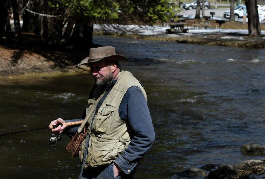 Stephen Stark of Ballston Spa tests the waters at Geyser Creek on the opening day of trout season on Monday, April 1, 2019, at Saratoga Spa State Park in Saratoga Springs, N.Y.  (Will Waldron/Times Union) Photo: Will Waldron, Albany Times Union / 40046539A