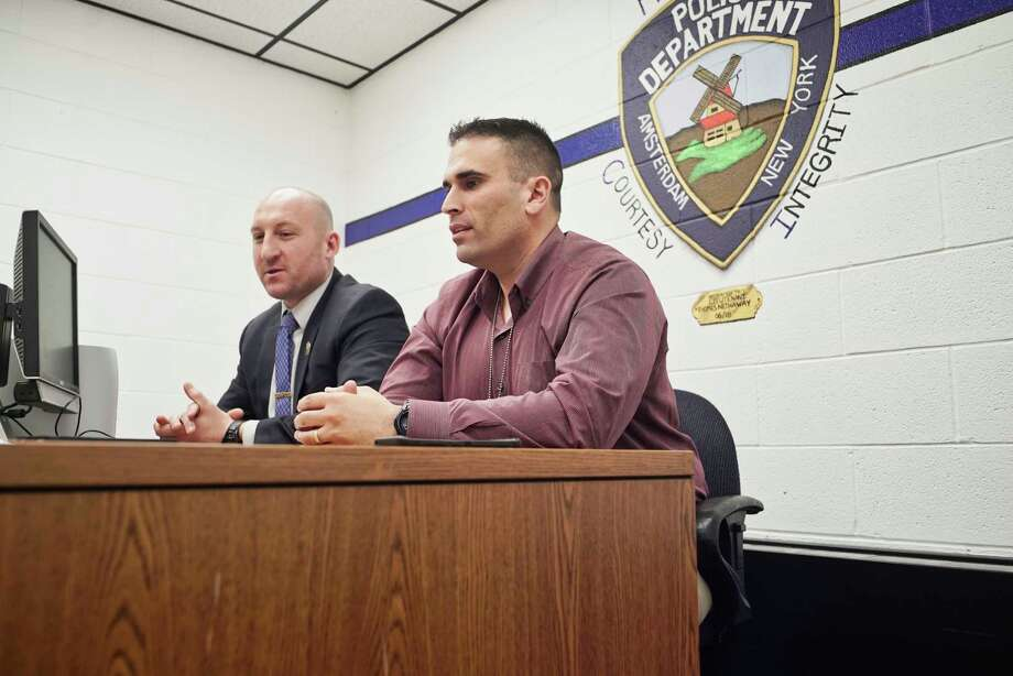 Amsterdam Police Detective Joseph Spencer, left, and Detective Sergeant Sal Megna said they don't do ICE's job but they partner with them like any other law enforcement agency.  Photo: Paul Buckowski, Albany Times Union / (Paul Buckowski/Times Union)