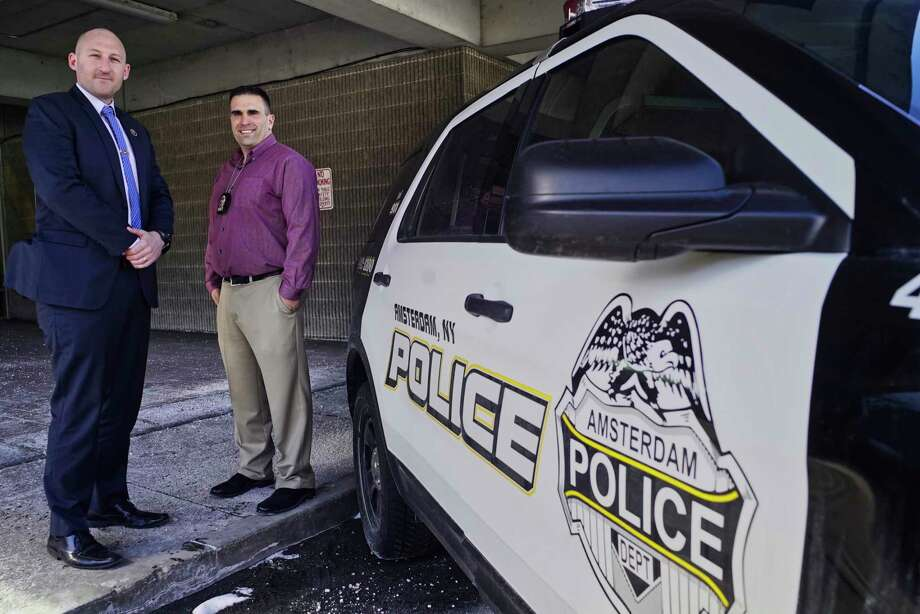 """Amsterdam Police Detective Joseph Spencer, left, and Detective Sergeant Sal Megna said it's """"officer's discretion"""" to ask about immigration status. Photo: Paul Buckowski, Albany Times Union / (Paul Buckowski/Times Union)"""
