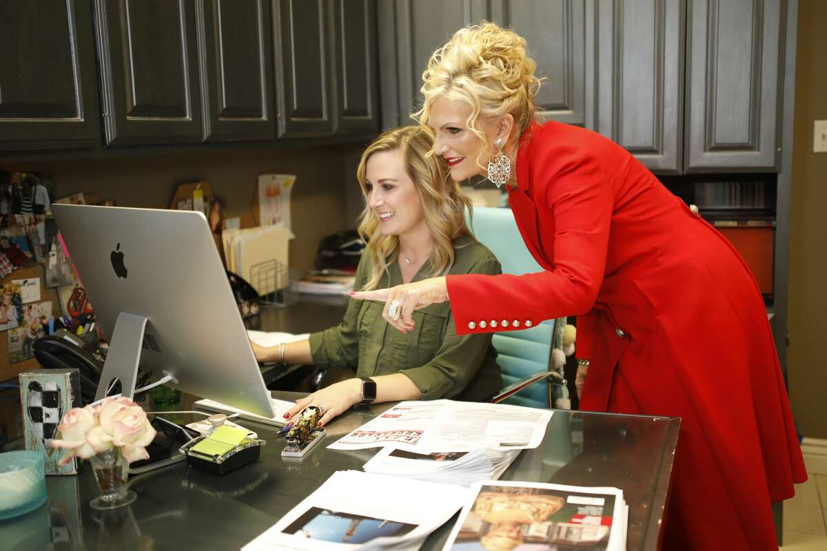 Victoria Printz, left, works with Erica Cross, marketing assistant, Feb. 26 at the Victoria Printz Team offices.