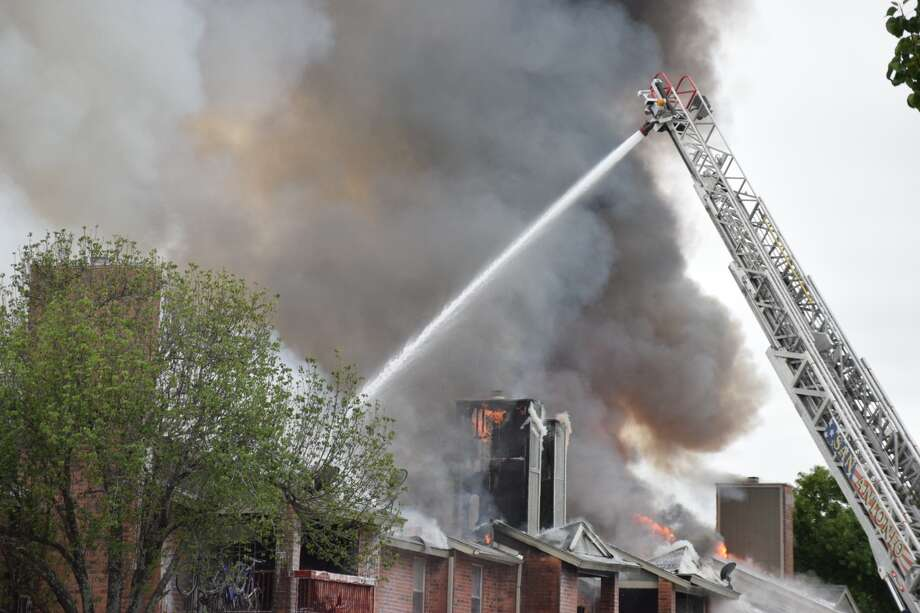 As many as 29 fire units responded to a two-alarm blaze at the Marbach Park apartment complex in San Antonio on Monday, April 1, 2019. Photo: Caleb Downs / San Antonio Express-News