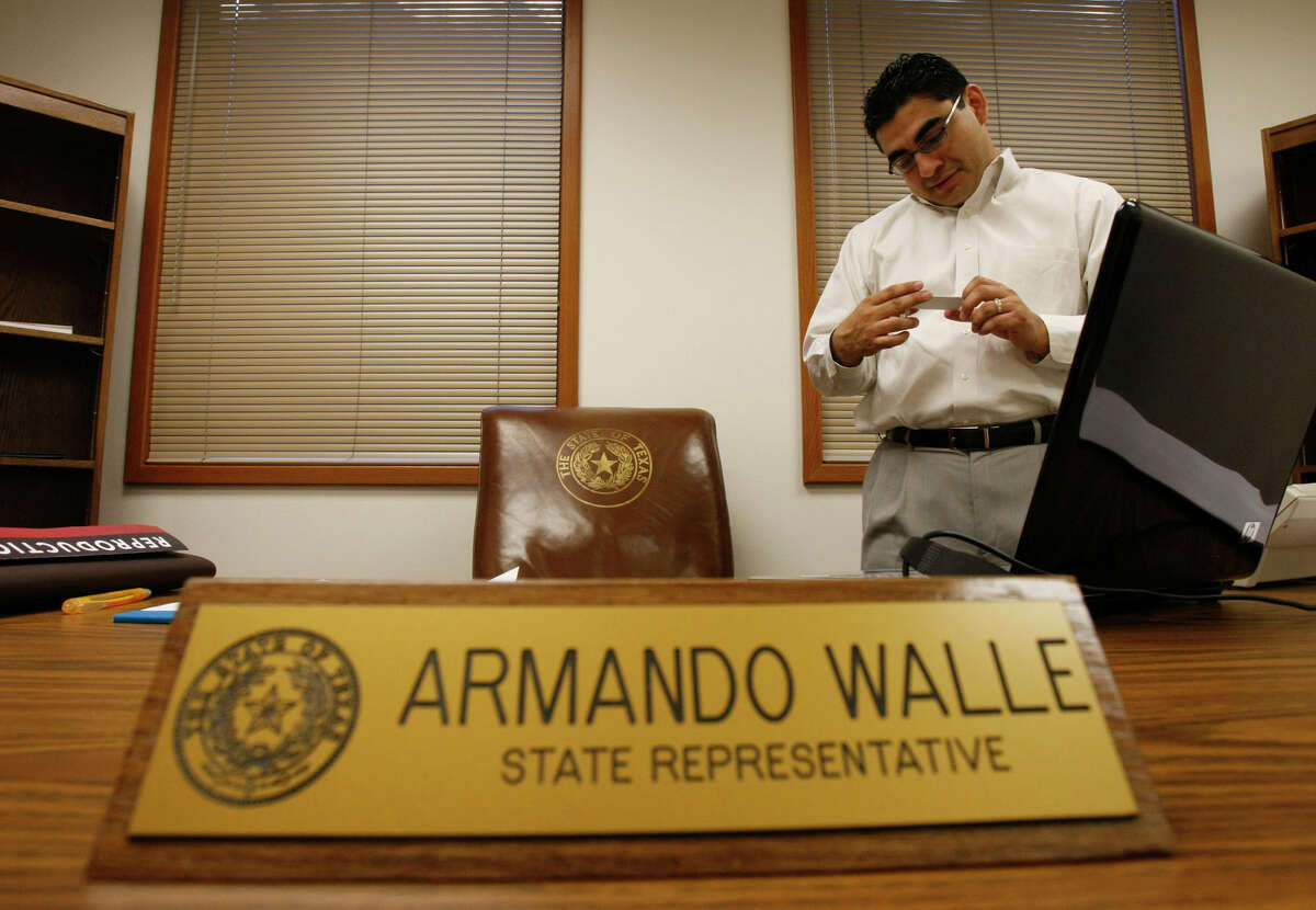 Walle, a Democrat, serves on the House appropriations, higher education and redistricting committees and was a state budget conferee in 2019. Original caption: Texas State Representative Armando Walle, 30, looks at his access badge, that will allow him to enter restricted areas around the Capitol, after he received the card earlier in the day as he moved into his new office at the Texas State Capitol on Monday, Jan. 12, 2009, in Austin. Walle, a product of the north part of Houston, will be sworn into office on Tuesday. ( Julio Cortez / Chronicle )