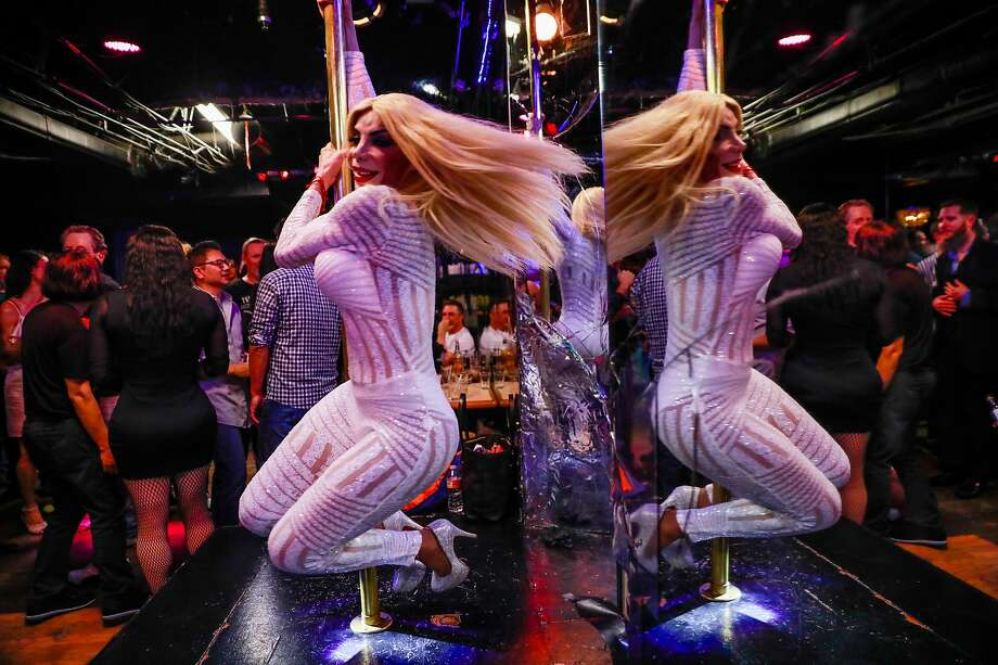 Liliana Rangel dances on a pole at Divas bar in San Francisco, California, on Saturday, March 30, 2019. Divas, the Tenderloin's three story bar devoted to transgender women celebrated it's final night on Saturday. Photo: Gabrielle Lurie / The Chronicle