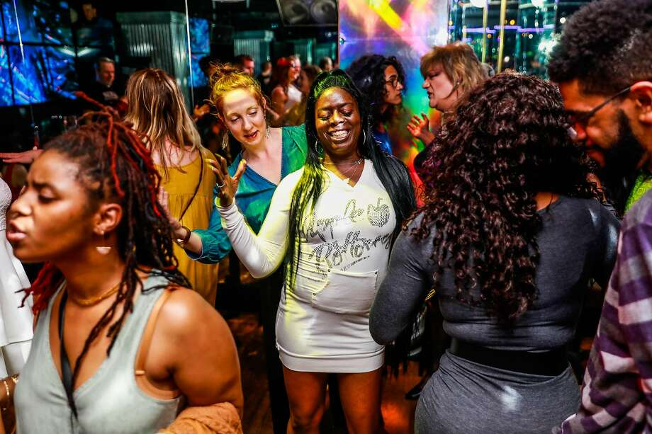People dance at Divas bar in San Francisco, California, on Saturday, March 30, 2019. Divas, the Tenderloin's three story bar devoted to transgender women celebrated it's final night on Saturday. Photo: Gabrielle Lurie / The Chronicle