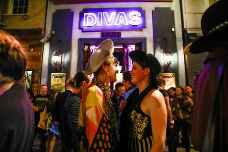 Monica Canilao chats with Paul Duke (right) outside Divas bar in San Francisco, California, on Saturday, March 30, 2019. Divas, the Tenderloin's three story bar devoted to transgender women celebrated it's final night on Saturday.