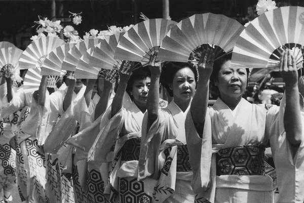 Oshin Dancers with fans at the Cherry Blossom Festival parade, April 29, 1984 Photo ran 04/30/1984, p. 3