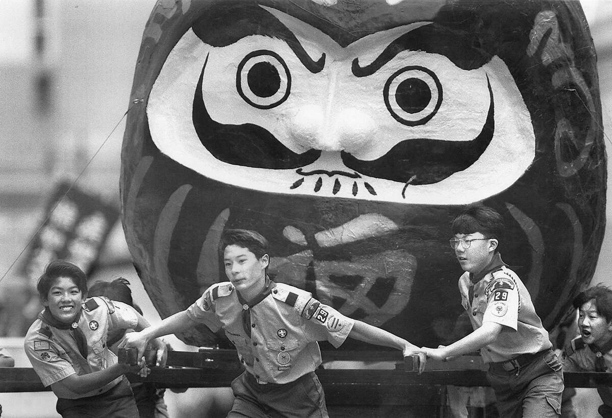Scouts from Troop 29 pull a giant replica of a Daruma, a Japanese good luck doll up Post St. towards Japantown at the Cherry Blossom Festival parade, April 25, 1993 Photo ran 04/26/1993, p. A15
