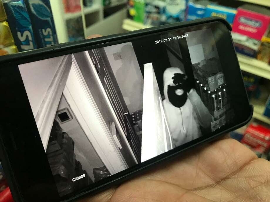 A picture of a video tape showing burglars breaking into La Placita Market on Hamilton Avenue over the weekend in Stamford. Photo: John Nickerson / Staff