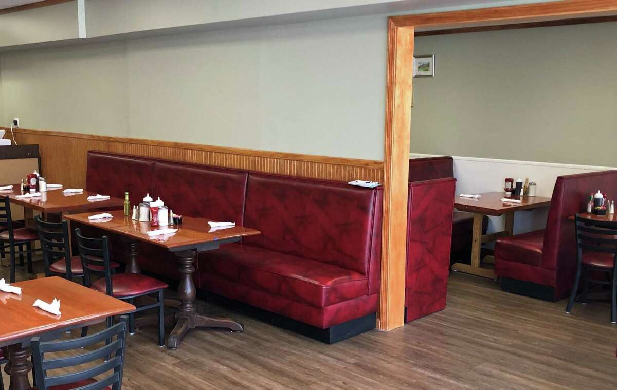 Spectrum/Johana's Restaurant on Main Street in New Milford recently underwent a complete renovation and expansion, bringing seating from 28 to 56. Above shows a portion of the expanded dining room and the original dining space. The restaurant re-opened March 25, 2019.