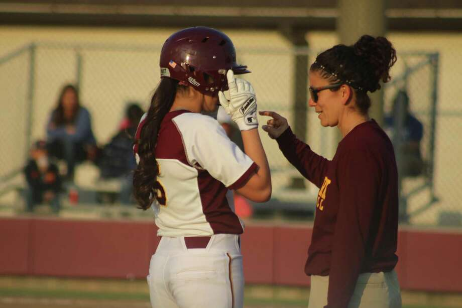 Deer Park head coach Errica Cantu provides some advice for Amaya Montano as she stands on third base during the Baytown Sterling game. Photo: Robert Avery