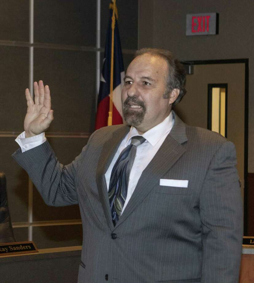 For the first time since the document was created fifteen years ago, a Conroe Independent School District trustee, Dale Inman, has decided to revoke his signature from the district's Board Member Code of Conduct. Here, Inman is sworn into office during a CISD Board of Trustees special meeting Friday, Nov. 16, 2018 at the CISD Administration Building in Conroe. Photo: Cody Bahn, Houston Chronicle / Staff Photographer / © 2018 Houston Chronicle