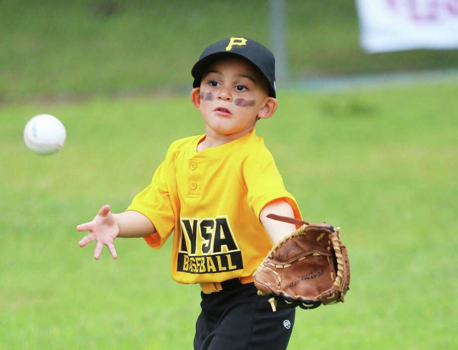 Three-year-old Jayce Keener has his eye on the ball as it approaches his glove. Photo: David Taylor / Staff Photo