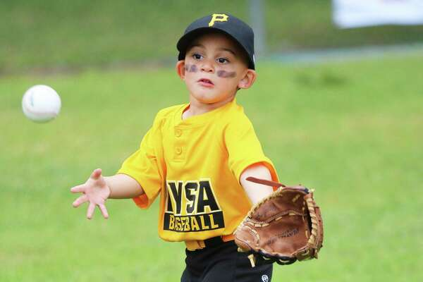 Three-year-old Jayce Keener has his eye on the ball as it approaches his glove.