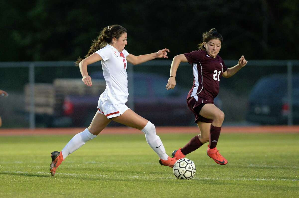 Kelsey Hranicky (6) of Memorial dribbles as Alycia Marin (21) of Northbrook challenges during the first half of a high school soccer game between the Northbrook Raiders and the Memorial Mustangs on Friday, March 22, 2019 at Northbrook High School, Houston, TX.