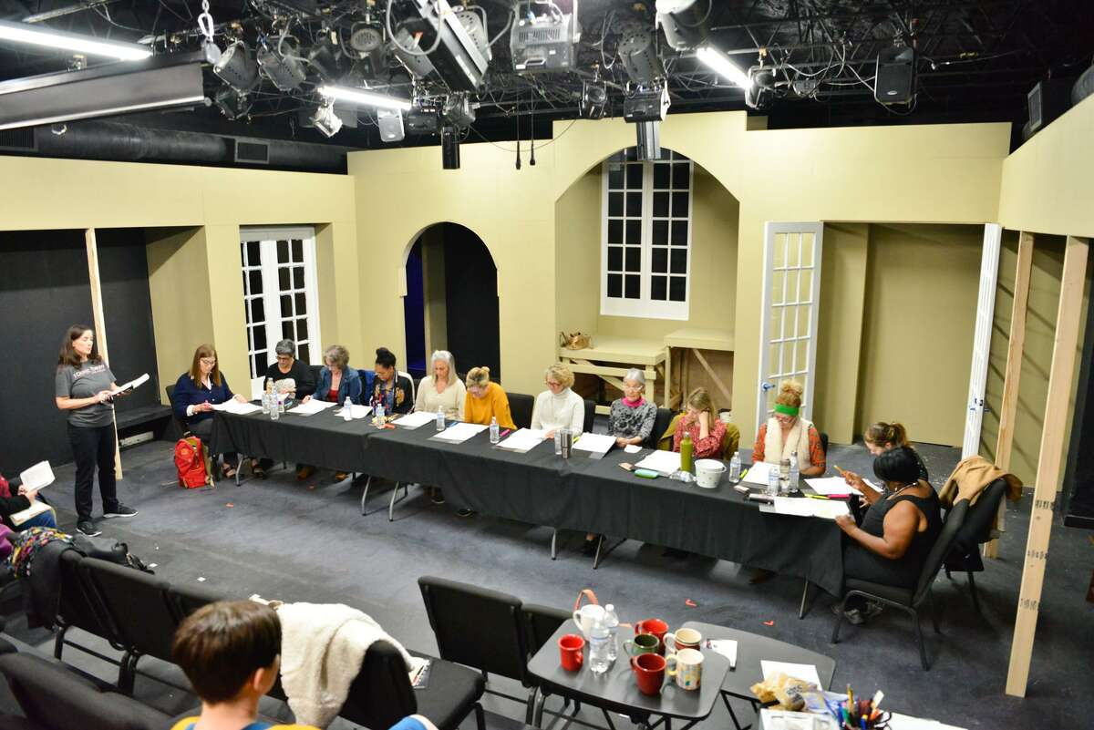 """Cast members go over their parts with director Christi Eanes during rehearsal for """"12,000 Voices,"""" a nationwide series of readings of the play """"Twelve Angry Men"""" by all-female casts. It is a project designed to illustrate the power of a single voice."""