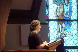 Amy Lappos, an aid for Congressman Jim Himes, reads a statement from him during the memorial service for Greenwich DTC Chairman Dave Roberson at the First Presbyterian Church Saturday afternoon, March 20, 2010. Roberson was killed in a car accident March 9, 2010.