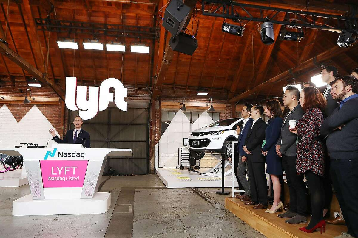 Los Angeles Mayor Eric Garcetti, left, speaks at the Nasdaq opening bell ceremony celebrating Lyft's initial public offering (IPO) on March 29, 2019 in Los Angeles, Calif. (Mario Tama/Getty Images/TNS)