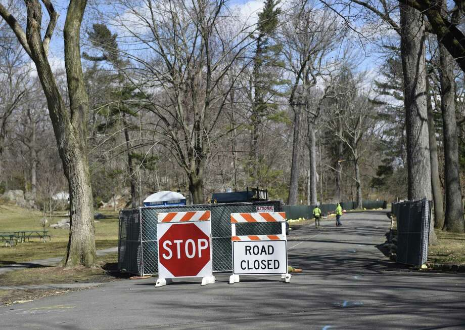 Construction crews close down Woods Road for construction at Bruce Park on Monday. Photo: Tyler Sizemore / Hearst Connecticut Media / Greenwich Time