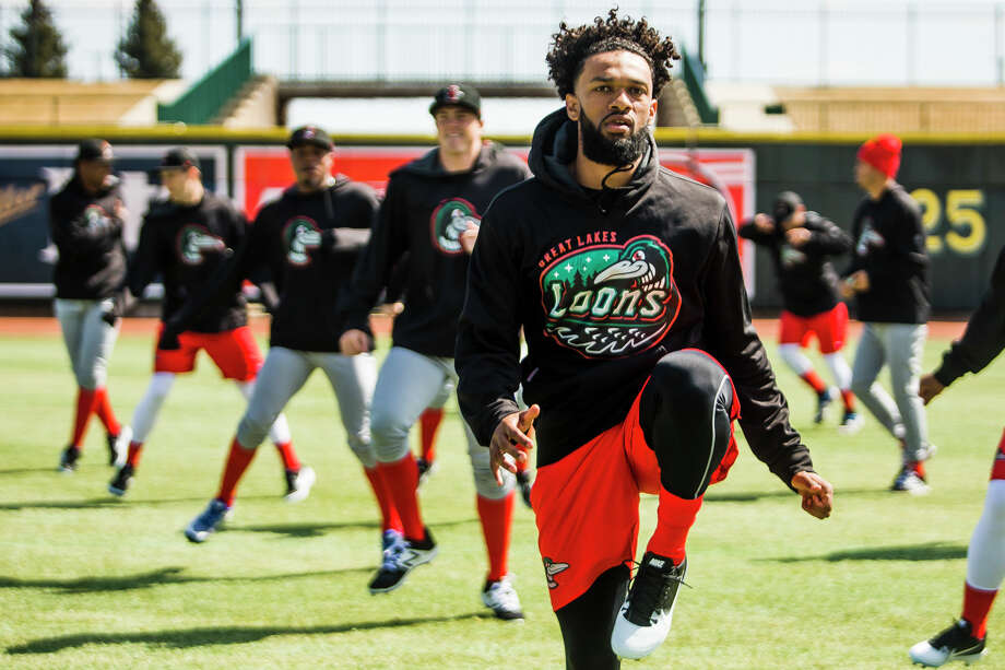 Great Lakes Loons pitcher Andre Jackson warms up for the team's first home practice of the season alongside teammates on Monday, April 1, 2019 at Dow Diamond. (Katy Kildee/kkildee@mdn.net) Photo: (Katy Kildee/kkildee@mdn.net)
