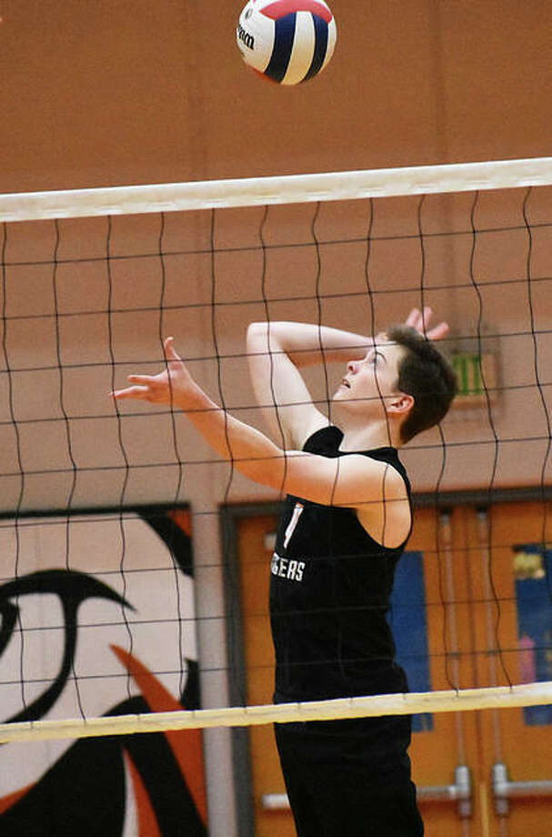 Edwardsville junior Max Sellers goes up for a kill attempt against Belleville East in Southwestern Conference action. Photo: Matt Kamp/The Intelligencer