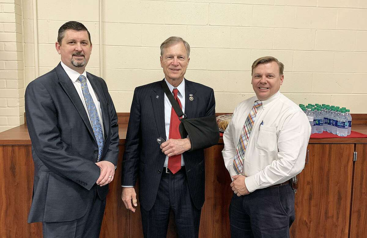 U. S. Rep. Brian Babin met with lawmen from across his nine-county district to discuss his TAPS Act that focused on preventative measures in school shootings and other common events. He is joined by Dayton Police Chief Robert Vine, left, and Capt. John Coleman.