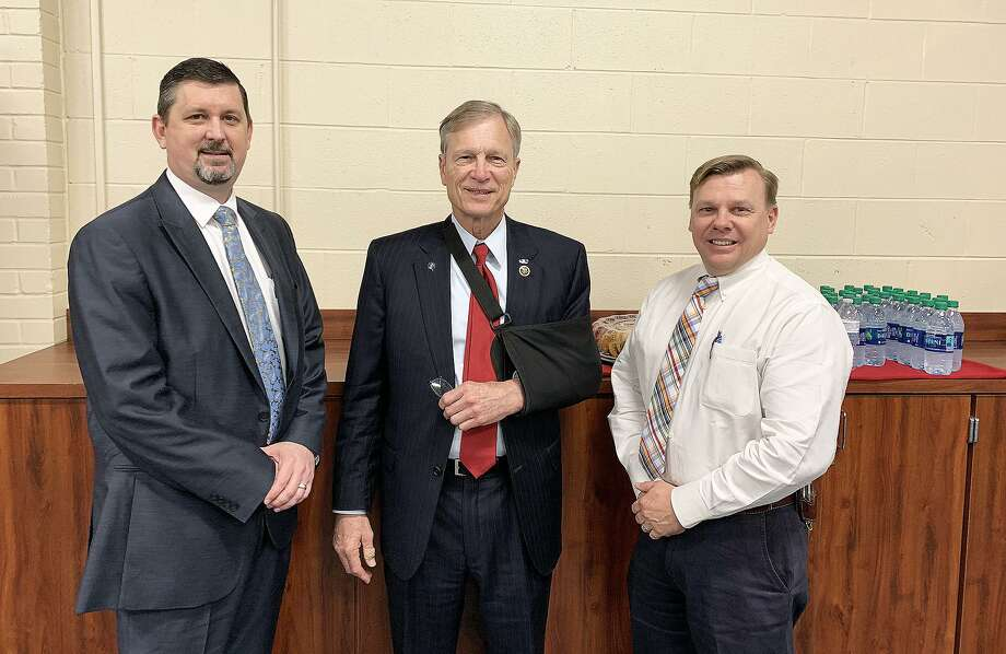 U. S. Rep. Brian Babin met with lawmen from across his nine-county district to discuss his TAPS Act that focused on preventative measures in school shootings and other common events. He is joined by Dayton Police Chief Robert Vine, left, and Capt. John Coleman. Photo: Submitted