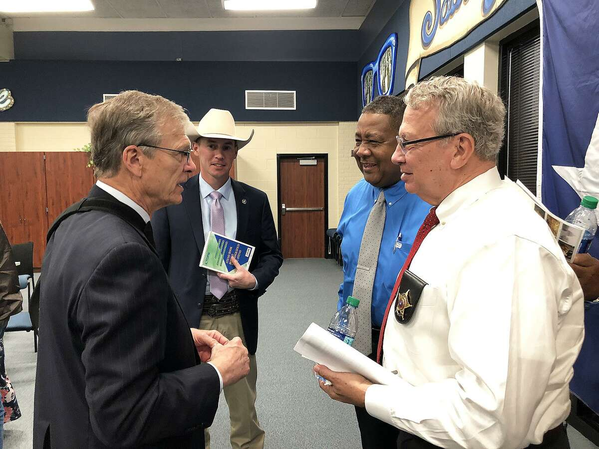 Texas Ranger Chris Cash, Cleveland Police Chief Darrell Broussard, and Liberty County Sheriff Bobby Rader talk over the TAPS Act with Congressman Brian Babin.